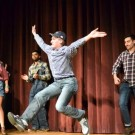 "College freshman Jay Gillen (center) performs in ""Old McSkellar Had a Farm,"" the latest performance from student improv group Rathskellar, in Harland Cinema last Saturday. Erin Baker/Staff."