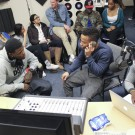 "Comedian DC Young Fly (left), Goizueta Business School junior Brandon Walker (center) and Goizueta Business School senior Daniel Assan (right) talk in the WMRE studio during Tuesday night's ""The Mix"" radio show. 