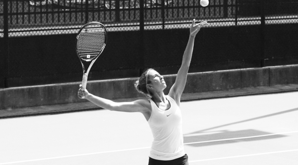 Junior Beatrice Rosen tosses the ball before a serve. Last season, she earned a spot on the all-University Athletic Association (UAA) First Team. | Courtesy of Emory Athletics