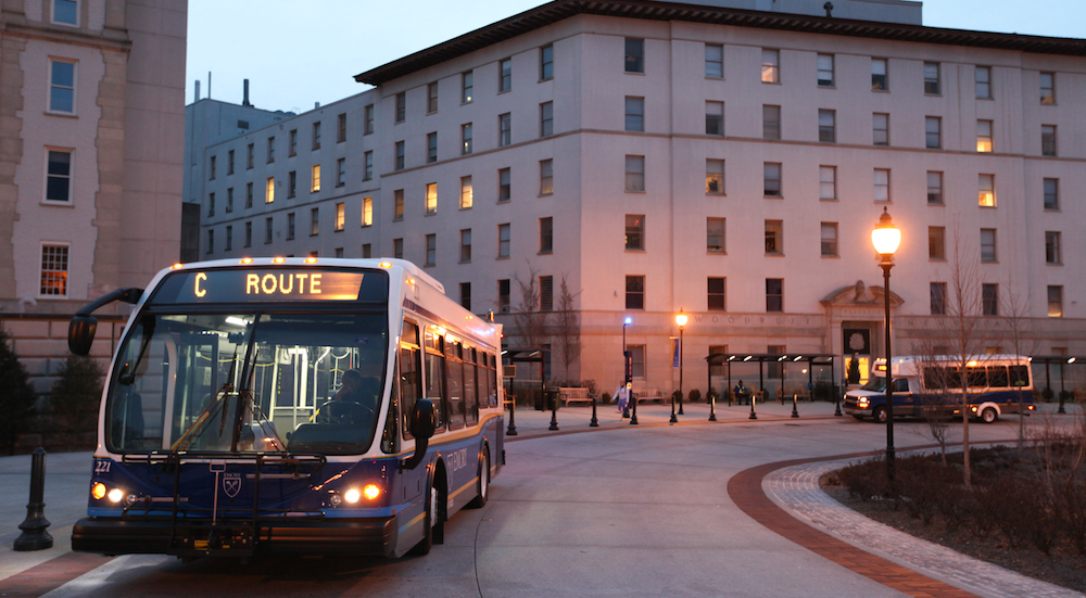 Busses pull out of Woodruff Circle. Photo by Jason Oh/ Staff