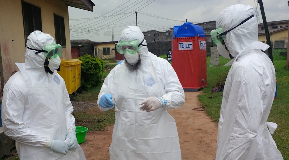 Nigerian physicians being trained by the World Health Organization (WHO) on how to put on and remove personal protective equipment (PPE) to treat Ebola patients. Photo courtesy of Wikimedia commons