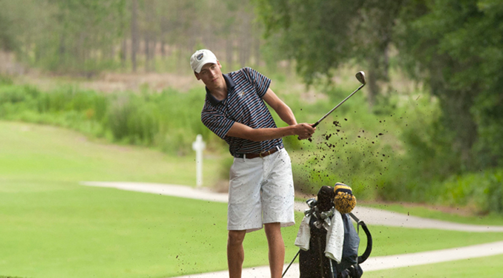 Senior Alex Wunderlich swings his club. Wunderlich and the golf team will host the Emory Spring Invitational at the Barnsley Resort in Adairsville (Ga.). | Courtesy of Emory Athletics