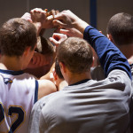 The team huddles before the game against LaGrange this past week. | Photo Courtesy of Emory Athletics