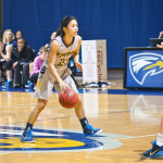Senior guard Ilene Tsao dribbles the ball in her final game as Eagle, Emory's loss to Rochester Saturday. | Courtesy of Emory Athletics