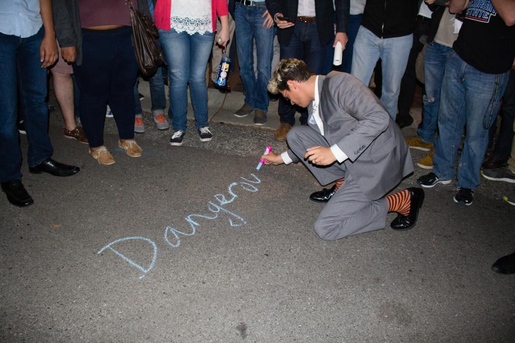"Milo Yiannopoulos chalks ""Dangerous Faggot xox"" in Asbury Circle on Wednesday night. / Julia Munslow, Executive Editor"