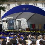 Graduates and supporters line the Emory Quadrangle at Commencement. | Ruth Reyes, Photo Editor