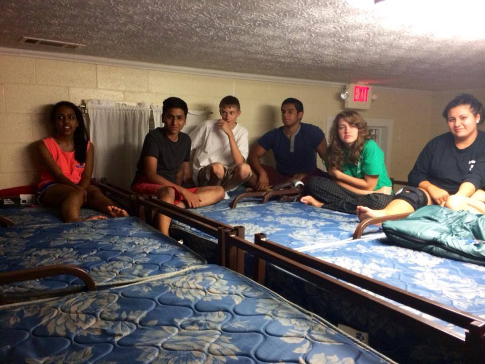 Alicia Johnson (right) and Faraaz Hossain (second from right) talk at the Fall 2014 Student Activities Committee retreat, where they met for the first time. / Courtesy of Alicia Johnson