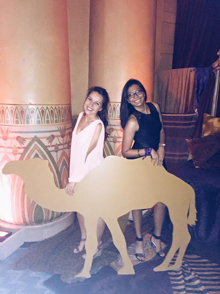 "Abinta Kabir (right) and Camilla Gallin (left) pose with a cutout of a camel for a photo at Oxford's 2015 Fall Formal at the Fox Theatre, themed ""Desert Oasis."" / Courtesy of Camilla Gallin"