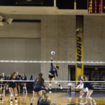 Freshman outside hitter Sara Carr spikes the ball for a point at this past weekend's Emory Invitational | Matthew Hammond /Contributing