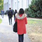 A woman sports a bright red coat, one of many examples of stylish winter attire on campus. Gemy Sethaputra/Senior Staff
