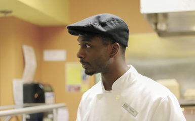 Robert Shaw works at the Woodruff Cafe, satisfying famished students with delectable late-night food ranging from chicken tenders to onion rings
