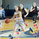 Senior guard Shellie Kaniut surveys the floor for the Eagles. Photo courtesy Emory Athletics.
