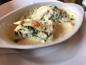 Generously topped with parmesan cheese, Marcello's lasagna exemplifies a non-tomato version of this classic dish. | Courtesy of Mitchell Friedman