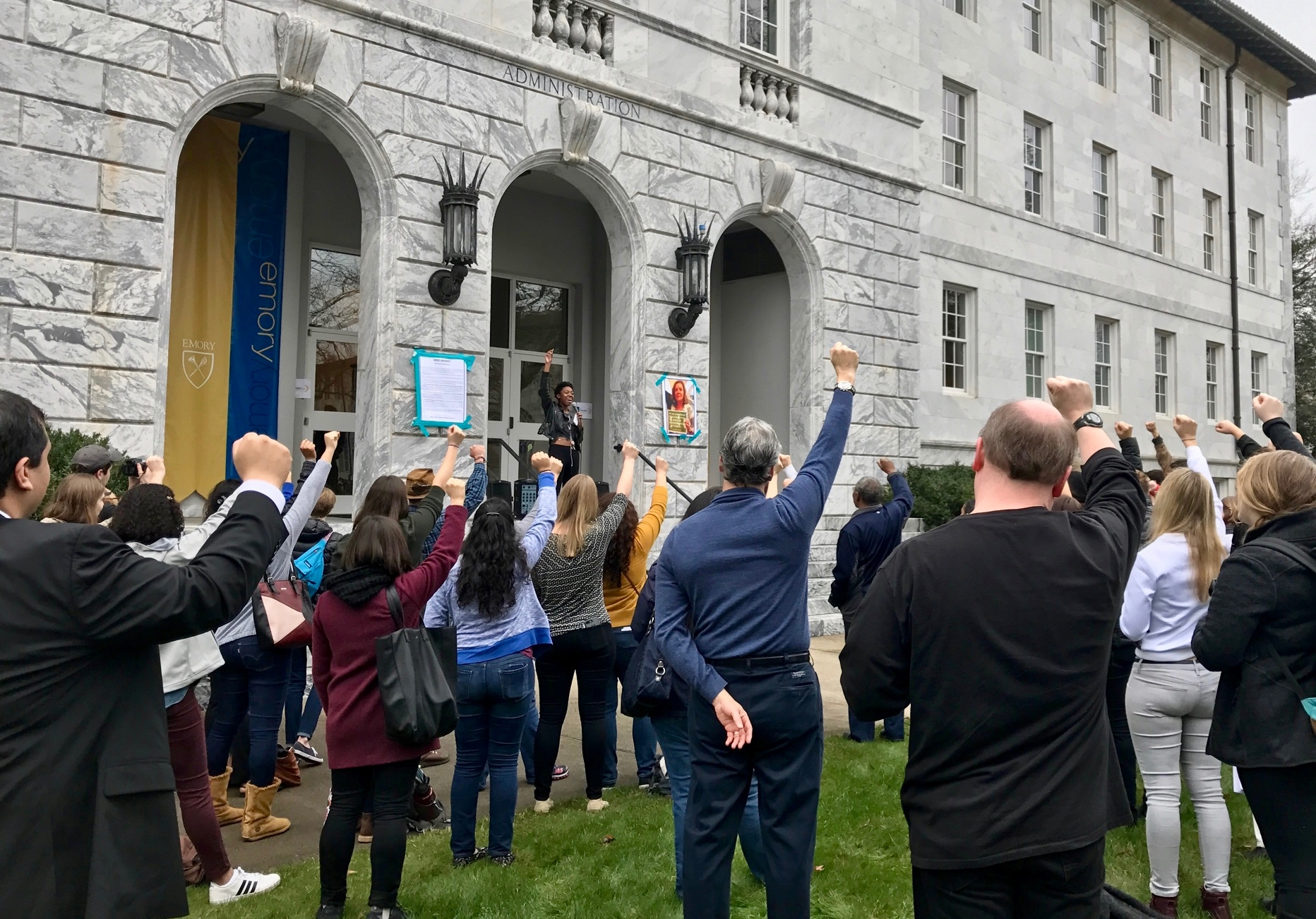 "Demonstrators raise their fists in unison, chanting ""We must love one another and protect each other. We have nothing to lose but our chains."" / Julia Munslow, Executive Editor"