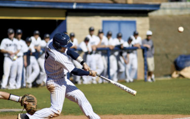 Junior shortstop Nick Chambers connects on a single to left center in the Eagles' game Friday against Huntingdon (Ala.). Chambers' 2 RBIs lifted Emory to a 12-7 victory. Photo courtesy Gemy Sethaputra.