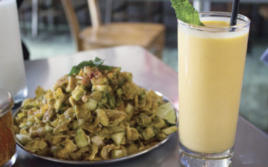 The spicy and sour green mango chaat is texturally rich and moderately spicy, making the sweet thickness of the mango lassi an optimal accompaniment for the dish. | Alisha Compton/Emory Life Editor