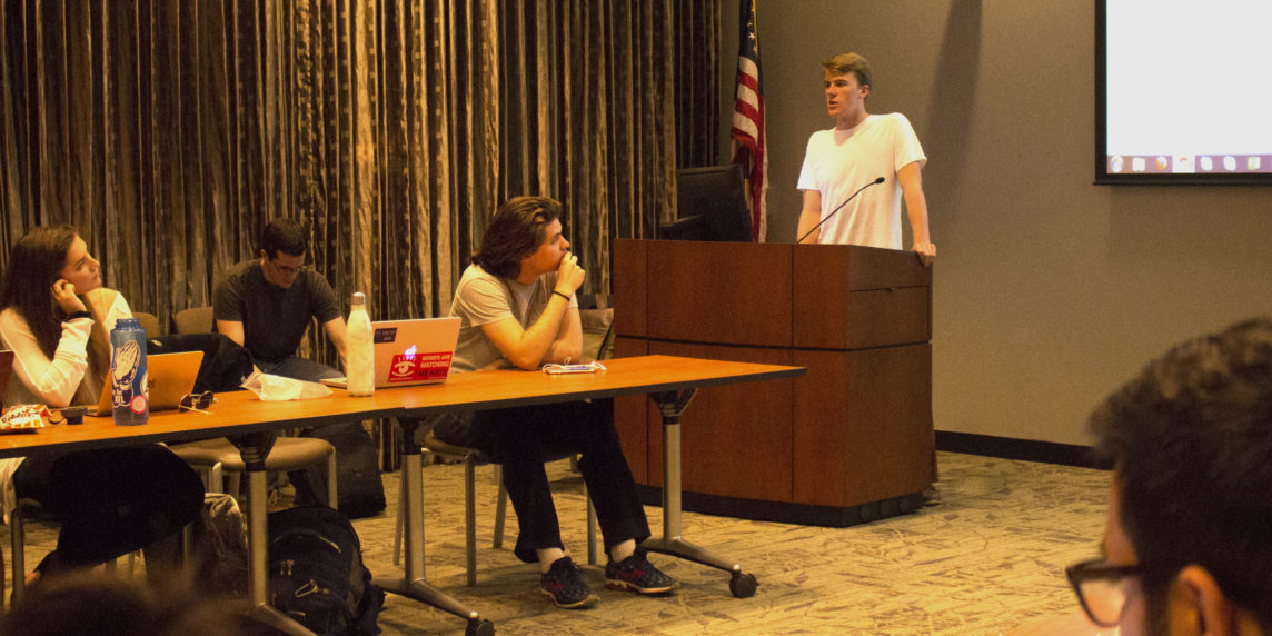 College-wide Representative and College junior Will Palmer (RIGHT) presents to the Student Government Association about the undergraduate government restructure Monday. / Michelle Lou, News Editor