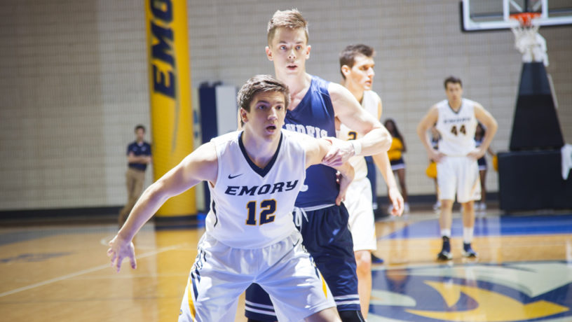Emory freshman guard Nick Tupanjanin shields away his defender. Tupanjanin and the Eagles dropped to 14-6 this past weekend. Photo courtesy of Emory Athletics.