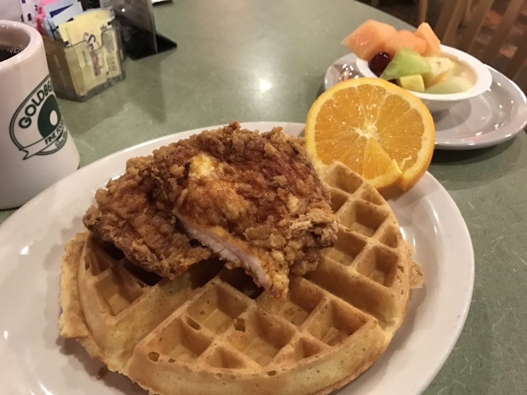 Goldberg's fried chicken and waffle platter is unlike the New York style food often found at Delis like this one and consists of golden brown waffle topped with a piece of crispy fried chicken and a light syrup drizzle.