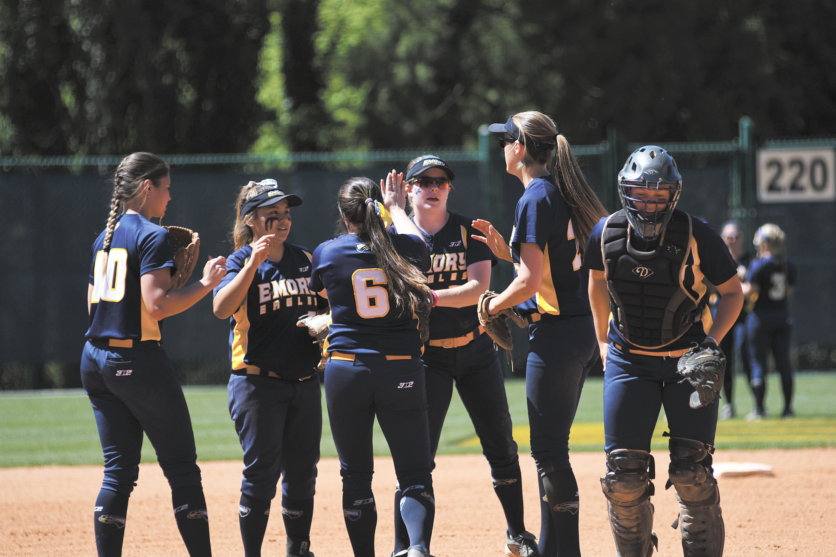 The infield celebrates around senior pitcher Brittany File (center). Gemy Sethaputra/Senior Staff.