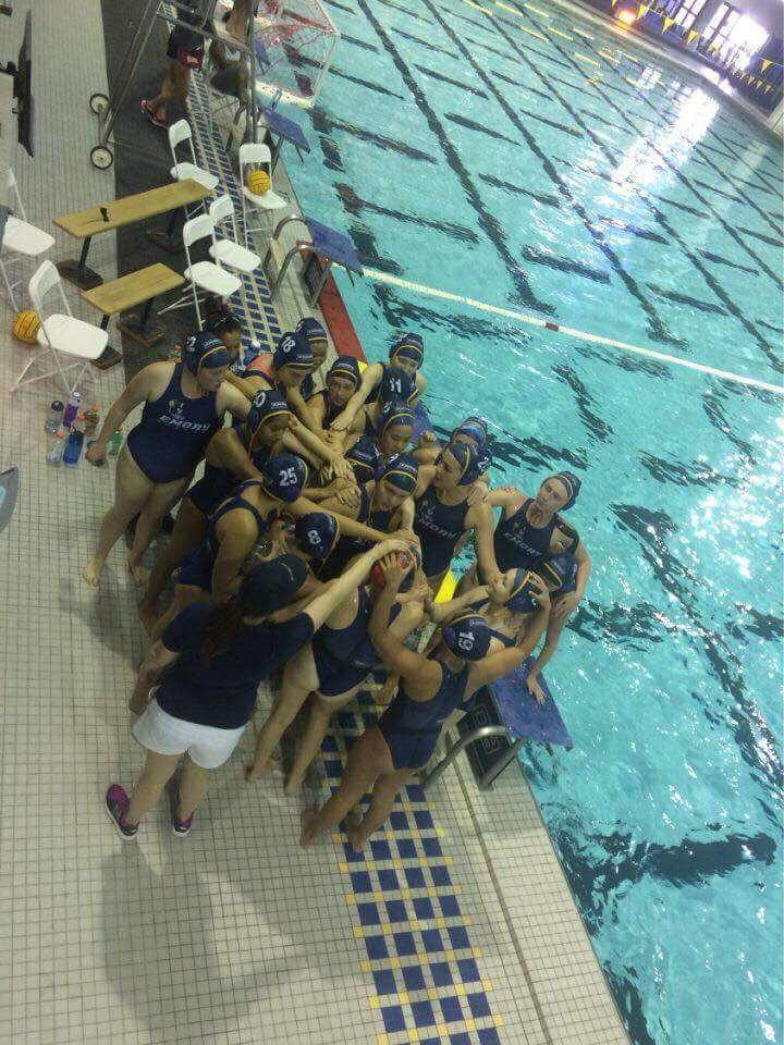 The women's water polo team huddles during the Division Championships. Photo courtesy of Ana Lee Pokrzywa.